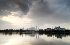 Kuala Lumpur City with reflection on the lake and dramatic cloud Royalty Free Stock Photography