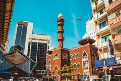 Kuala Lumpur cityscape. Religious and modern architecture. Travel to Malaysia. Mosque Masjid India. City tour. Street market area. Tourism industry. Building Stock Images