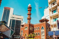 Kuala Lumpur cityscape. Religious and modern architecture. Travel to Malaysia. Mosque Masjid India. City tour. Street market. Tour. Ism industry. Building facade Stock Photo