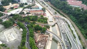 Kuala Lumpur federal highway during peak hours. Time-lapse during peak hours of Kuala Lumpur federal highway from Regalia Suites level 33th on cloudy afternoon stock video footage