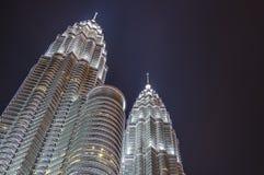 KUALA LUMPUR - KLCC. KUALA LUMPUR - MAY 22: Beautiful night lighting of Petronas Twin Towers (PTT) May 22, 2013 in Kuala Lumpur. The skyscraper height is 451.9m Royalty Free Stock Photos
