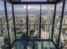 KUALA LUMPUR / MALAYSIA - 2019: Amazing city view through transparent glass balcony at Sky box in Menara KL tower. KUALA LUMPUR / MALAYSIA - JANUARY 2019 royalty free stock photography