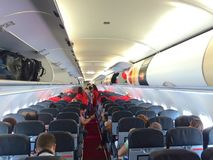 KUALA LUMPUR, MALAYSIA - APR 4th 2015: interior of AirAsia Airbus A320-200 cabin, AirAsia Berhad is a Malaysian low-cost. Airline headquartered near Kuala stock images