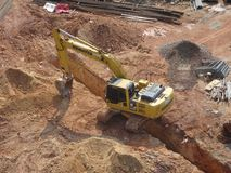 Excavators machine is heavy construction machine used to excavate soil and lifting material. KUALA LUMPUR, MALAYSIA -APRIL 16, 2019: Excavators machine is heavy stock photography
