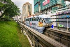 KL Monorail train enters the Maharajalela Monorail station in Kuala Lumpur Royalty Free Stock Photos