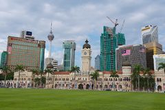 View to the Sultan Abdul Samad building with modern buildings at the background in Kuala Lumpur, Malaysia. KUALA LUMPUR, MALAYSIA - AUGUST 29, 2009: View to the Royalty Free Stock Photos
