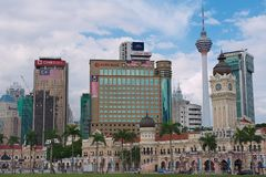 View to the Sultan Abdul Samad building with modern buildings at the background in Kuala Lumpur, Malaysia. KUALA LUMPUR, MALAYSIA - AUGUST 29, 2009: View to the Royalty Free Stock Images