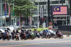 Kuala Lumpur, Malaysia - circa September 2015: Motorbike riders in street traffic on the road in Kuala Lumpur,  Malaysia. Kuala Lumpur, Malaysia - circa Stock Photo