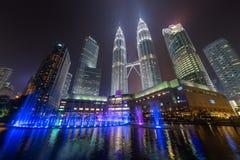 Kuala Lumpur, Malaysia - circa September 2015: Panorama of Petronas Twin Towers and Lake Symphony by  night Royalty Free Stock Photos
