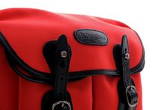 Close up of Billingham brand on Neon red Hadley small shoulder bag Royalty Free Stock Images