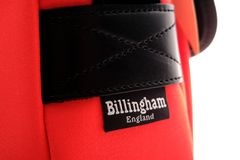 Close up of Billingham brand on Neon red Hadley small shoulder bag Stock Photos