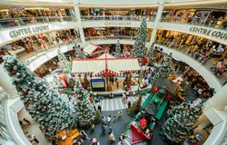 Christmas decoration in Mid Valley Megamall. People can seen exploring and shopping around it. Royalty Free Stock Image