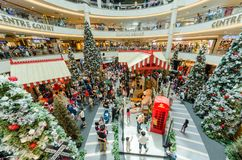 Christmas decoration in Mid Valley Megamall. People can seen exploring and shopping around it. Stock Images
