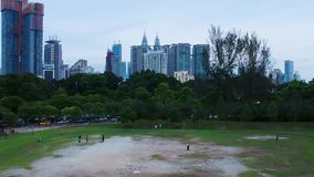 Kuala Lumpur, Malaysia, December 20, 2017: People spend their free time at the Taman Tasik Perdana park stock video footage
