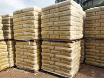 Stock pile of portland cement in commercial bags. royalty free stock photos