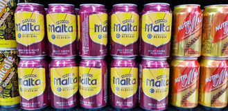 Cans of non-alcohol malt drink. KUALA LUMPUR, MALAYSIA - JANUARY 17, 2018: Cans of non-alcohol malt drink at Mid-Valley Shopping Centre, Kuala Lumpur Royalty Free Stock Photo