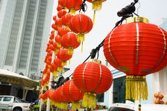 Red Lanterns Hung Up Between Poles stock photo