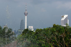 Kuala Lumpur, Malaysia - January 16, 2016: view of the KL Tower commucation  between palms and plant Stock Images