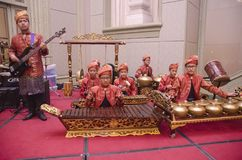 KUALA LUMPUR, MALAYSIA 12 JULY 2017: Group of Malaysian with songket performing Gamelan Orchestra and modern music instrument on h Royalty Free Stock Photos