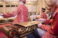 KUALA LUMPUR, MALAYSIA 12 JULY 2017: Group of Malaysian with songket performing Gamelan Orchestra and modern music instrument on h Royalty Free Stock Image
