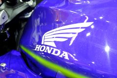 Honda logos at the motorcycle body. KUALA LUMPUR, MALAYSIA -JULY 29, 2017: Honda logos at the motorcycle body. Honda is one of the famous motorcycle manufacture stock photos