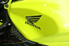 Honda logos at the motorcycle body. KUALA LUMPUR, MALAYSIA -JULY 29, 2017: Honda logos at the motorcycle body. Honda is one of the famous motorcycle manufacture stock photo