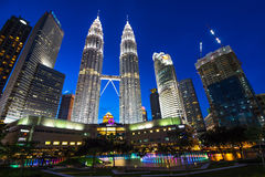 KUALA LUMPUR, MALAYSIA - July 18, 2016: Petronas Twin Towers with Musical fountain at night in Kuala Lumpur, Malaysia Royalty Free Stock Image