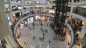 Kuala Lumpur, Malaysia - July 18, 2018 : Time lapse of people are walking and shopping around it and interior at Suria KLCC