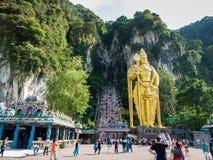 KUALA LUMPUR, MALAYSIA - MAR 1: Tourist and Lord Murugan Statue Stock Image
