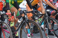 Group of female cyclists are ready to be on the starting line. KUALA LUMPUR, MALAYSIA -MARCH 16, 2019: Group of female cyclists are ready to be on the starting royalty free stock photography