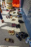 Kuala Lumpur, Malaysia - March 9, 2017: Shoes spread outside a Hindu temple, they have to be removed as a sign of Stock Image