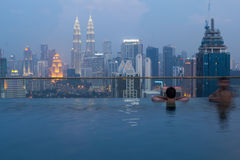 KUALA LUMPUR,MALAYSIA- MAY 2 2016: the KLCC buildings views from an infinity pool Stock Photo