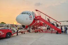 AirAsia. KUALA LUMPUR, MALAYSIA - MAY 02, 2014: people boarding at AirAsia aircraft at the airport. AirAsia is the largest airline in Malaysia by fleet size and Stock Photo