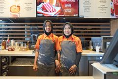 McDonald's. KUALA LUMPUR, MALAYSIA - MAY 09, 2016: Staff members of McCafe. McCafe is a coffee house style food and drink chain, owned by McDonald's Royalty Free Stock Images