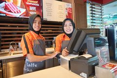 McDonald's. KUALA LUMPUR, MALAYSIA - MAY 09, 2016: Staff members of McCafe. McCafe is a coffee house style food and drink chain, owned by McDonald's Stock Photography