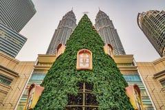 Kuala Lumpur, Malaysia, November 18, 2018: Big Christmas tree and city skyscrappers in the tropics