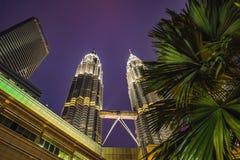 Kuala Lumpur, Malaysia, November 18, 2018: Palm trees and skyscrapers in Kuala lumpur