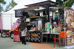 Street hawkers using food trucks to serve their business to the customer. KUALA LUMPUR, MALAYSIA - NOVEMBER 16, 2018: Street hawkers using food trucks to serve stock images