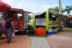 Street hawkers using food trucks to serve their business to the customer. KUALA LUMPUR, MALAYSIA - NOVEMBER 16, 2018: Street hawkers using food trucks to serve stock photography