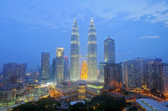 KUALA LUMPUR, MALAYSIA - OCT19: Petronas Twin Towers at twilight on Oct 19, 2015 in Kuala Lumpur. Royalty Free Stock Photos