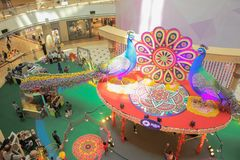Decorations of Diwali peacock inside Suria KLCC in Kuala Lumpur, Malaysia. Kuala Lumpur, Malaysia - October 21, 2017: Decorations of Diwali peacock inside Suria Royalty Free Stock Image