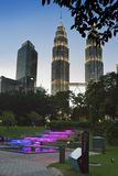KUALA LUMPUR, MALAYSIA- OCTOBER 13, 2016: evening view of the park and a tower Petronas in the downtown Royalty Free Stock Photo