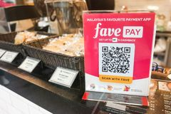 KUALA LUMPUR, MALAYSIA, September 17, 2019: Retail outlet restaurant displaying signage of Favepay.  Online payment via Fave Pay