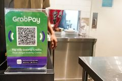 KUALA LUMPUR, MALAYSIA, September 17, 2019: Retail outlet restaurant displaying signage of Grabpay.  Online payment via Grabpay is