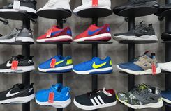 Various sports footwear at store Stock Photos