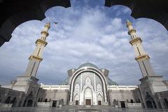 Kuala Lumpur Mosque. KUALA LUMPUR, MALAYSIA - January 14, 2017: A wide angle in framing Federal Territory Mosque or Masjid Wilayah over a bright blue sky Stock Photo
