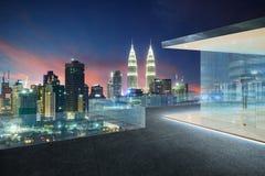 Kuala Lumpur skyline at night with balcony view Stock Photos