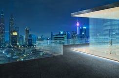 Kuala Lumpur skyline at night with balcony view Stock Photography