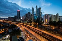 Kuala Lumpur skyline and skyscraper with highway road at night i Royalty Free Stock Image