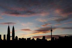 Kuala Lumpur skyline at sunset Stock Photos
